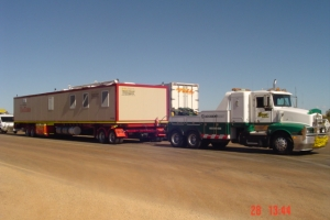 heavy-recovery-truck-towing-mobile-accomodation-unit